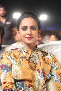 Actress Rakul Preet Singh Stills in Short Dress at Dhruva Pre Release Function  0032.JPG