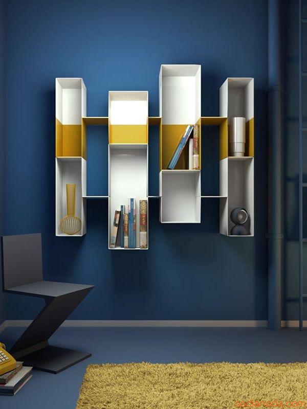 ... le pareti sono bianche e sono in diverse tonalità di blu gli arredi
