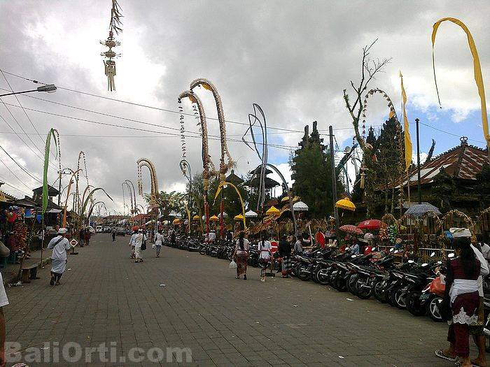 Roads in front of Batur Temple is filled with motorcycles.