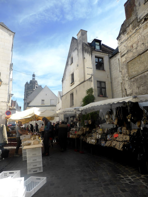 Market stalls in Loches with the bell tower in the background