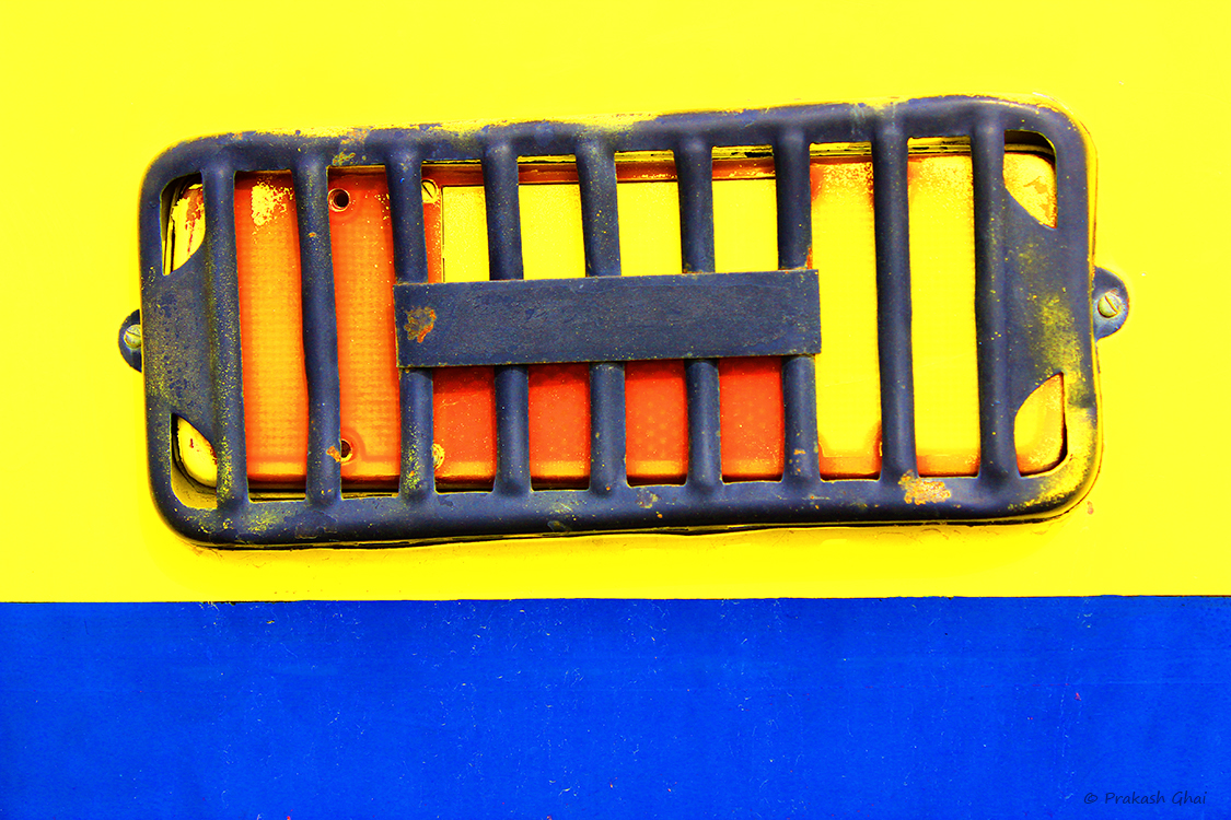 A Minimalist Photo of  the Backlight of a yellow School Bus