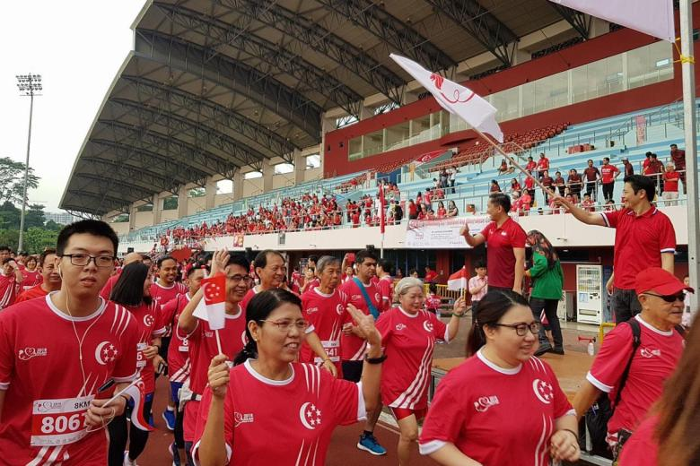 5,000 people take part in a 3km walk or an 8km run to mark Singapore's 53rd birthday.