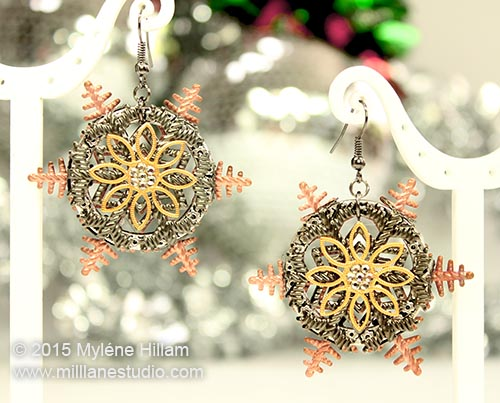 Christmas Snowflake earrings combining gold filigree flower with gunmetal and copper snowflakes.