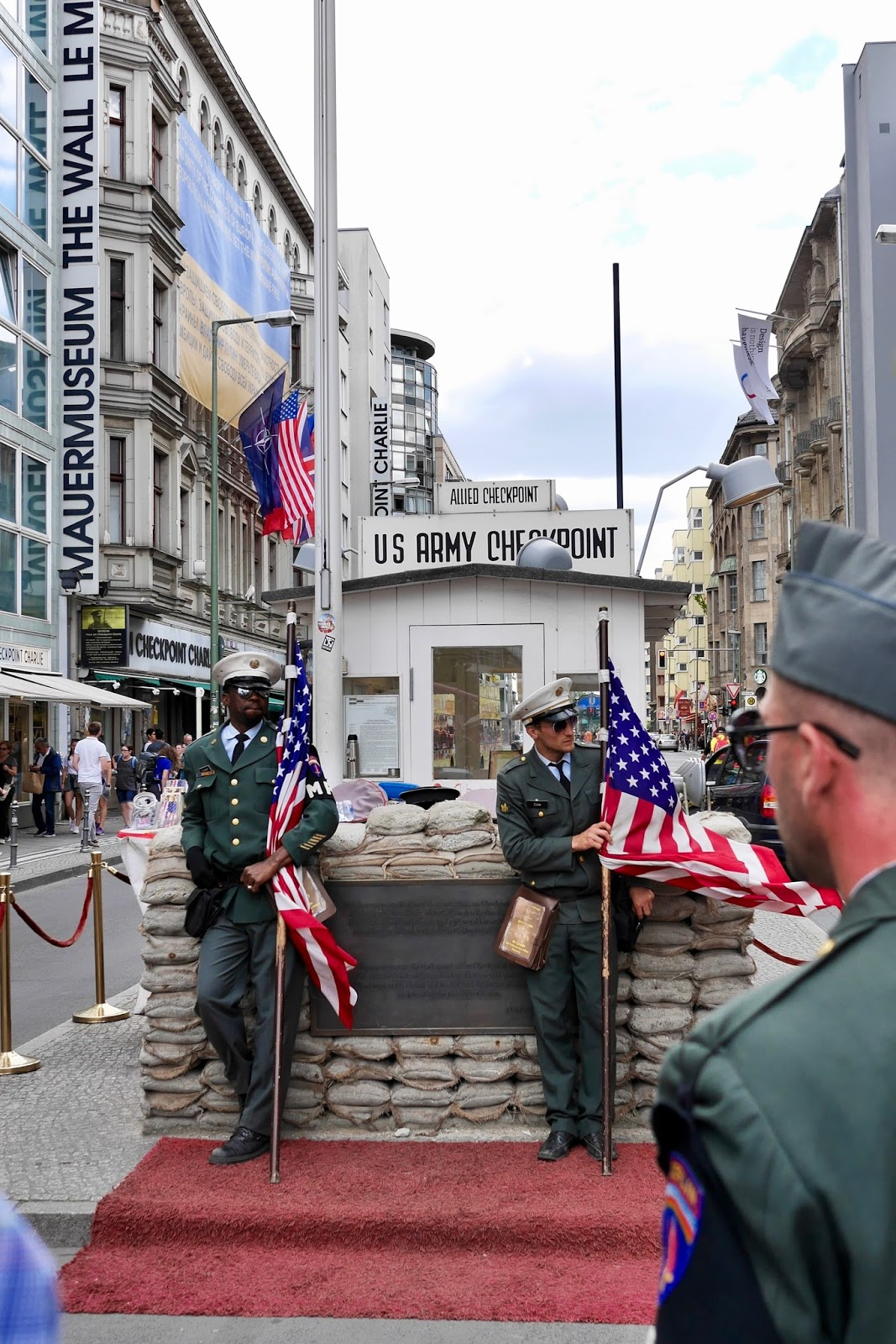 A replica of check point Charlie in Berlin which amazingly standing in the middle of a busy road. by www.CalMcTravels.com. Cal McTravels