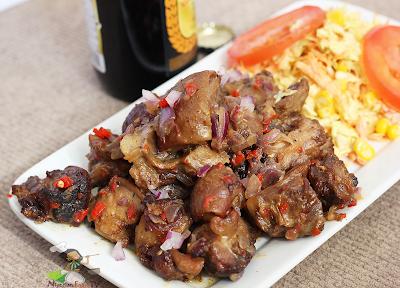 Nigerian Asun Recipe ( spicy smoked peppered goat meat) asun | Nigerian Small Chop, nigerian fod tv
