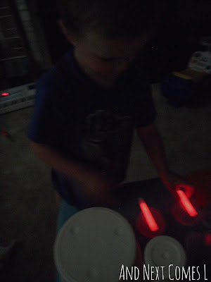 Drumming with glow sticks from And Next Comes L