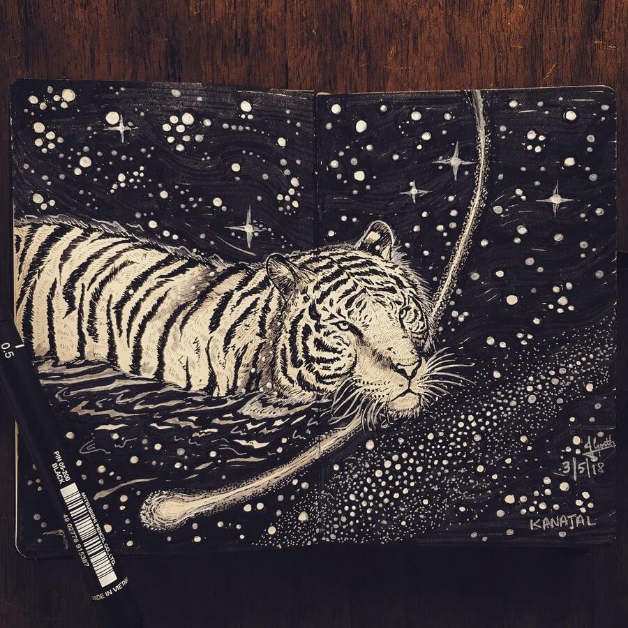 01-Tigress-swimming-Goutham-Tulasi-www-designstack-co