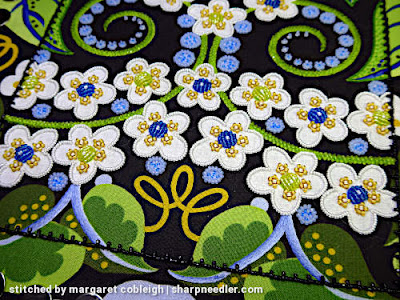 All the small blue circles embroidered with beads (except two). (Wild Child Japanese Bead Embroidery by Mary Alice Sinton)
