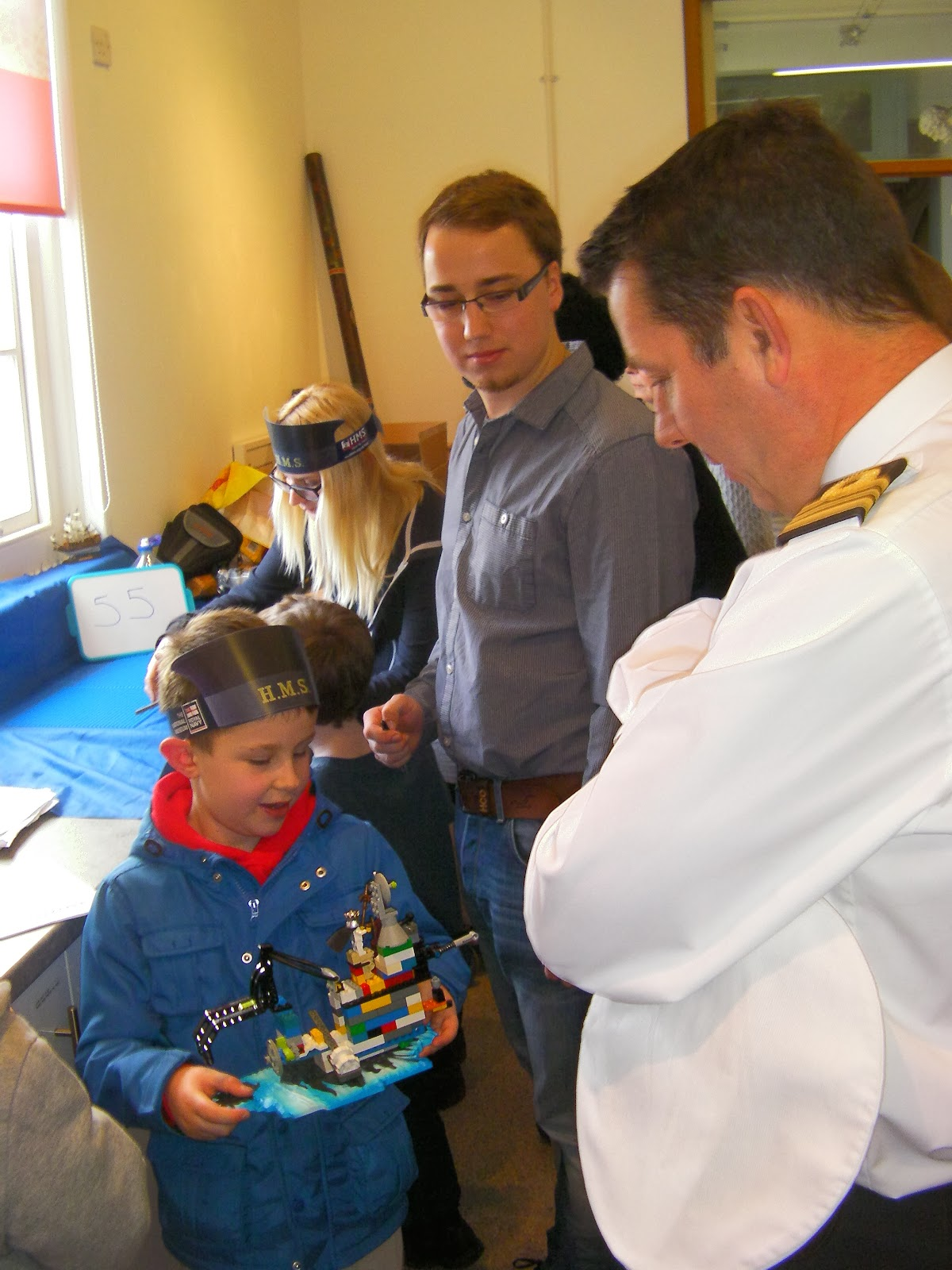 naval officer captain of hms victory approves of entrant in lego shipbuilding competition