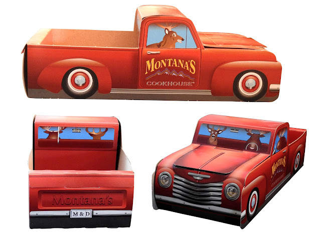 A red half-ton truck made of cardboard from Montana's Cookhouse.