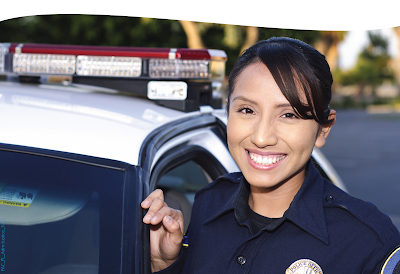 image of a young, female police officer smiling at the camera
