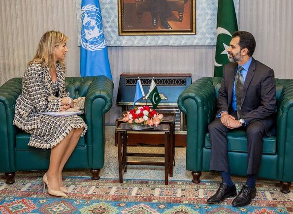 Queen Maxima wore a cotton and wool blend tweed dress and jacket by Oscar de la Renta. Prime Minister Imran Khan
