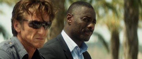 Sean Penn and Idris Elba in The Gunman