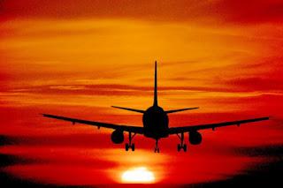 Image: Aircraft landing into a sunset. Airbus A330 (c) FreeFoto.com. Photographer: Ian Britton