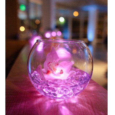 Lighting in fish bowl for wedding decoration, flowers are topped on aqua crystal beads