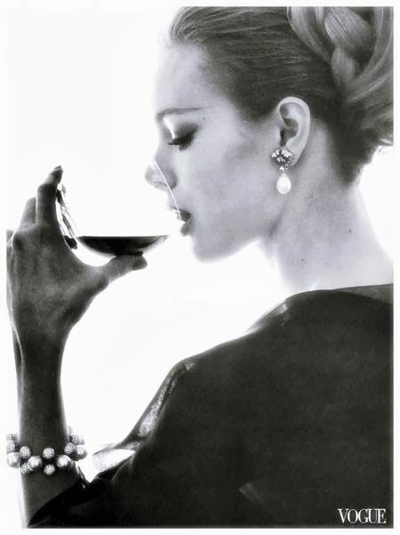 Monique Chevalier drinking wine photographed by Bert Stern for Vogue