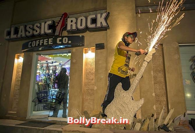 Interior designer Zahra Afridi uses a circular saw as she sculpts a stone guitar outside the Classic Rock Coffee cafe in Islamabad., You will love these Pakistani Bold Women of 2014