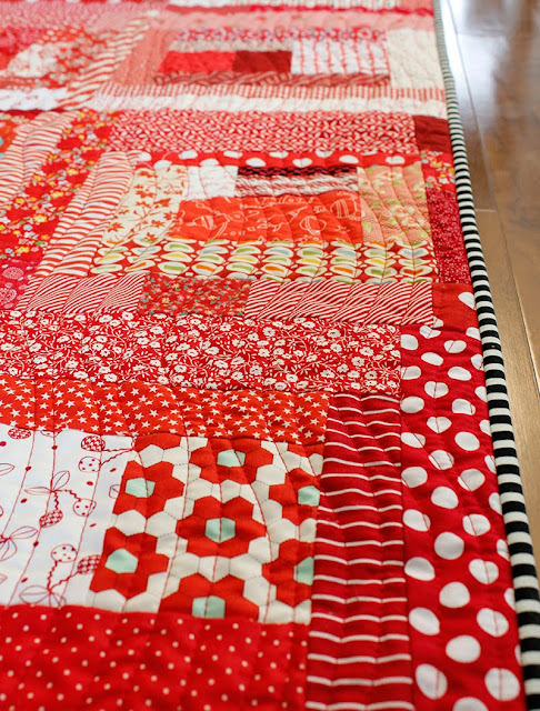 Wavy line quilting on a cute red scrappy quilt