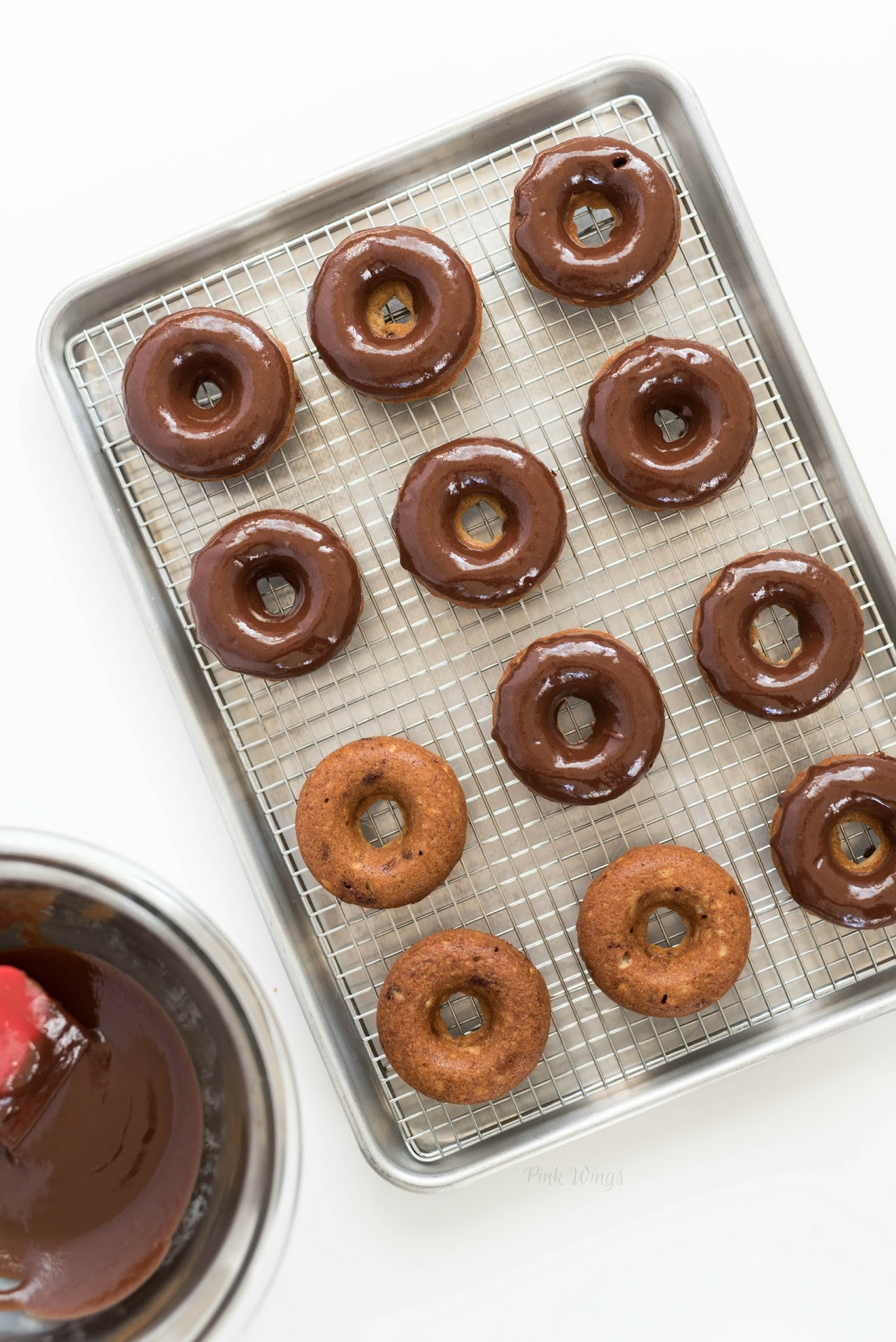 baked donut recipe, chocolate doughnuts, football dessert recipe, football party ideas, football doughnuts, gold doughnuts, gold desserts, gold party ideas, banana dessert, tailgating, unique football food, recipe food prep photography, chocolate glaze recipe, glaze for donuts, doughnut frosting icing