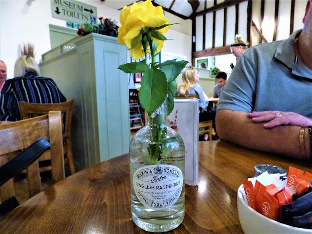 Gin liqueur bottle repurposed as a vase at Tiptree Tea Rooms in Essex