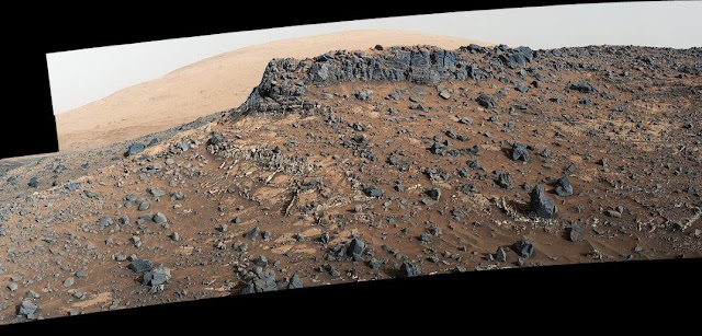This view from the Mast Camera (Mastcam) on NASA's Curiosity Mars rover shows a site with a network of prominent mineral veins below a cap rock ridge on lower Mount Sharp. The APXS instrument on Curiosity discovered unusual material in these veins that has the highest germanium concentrations found in Gale Crater. Credit: NASA.