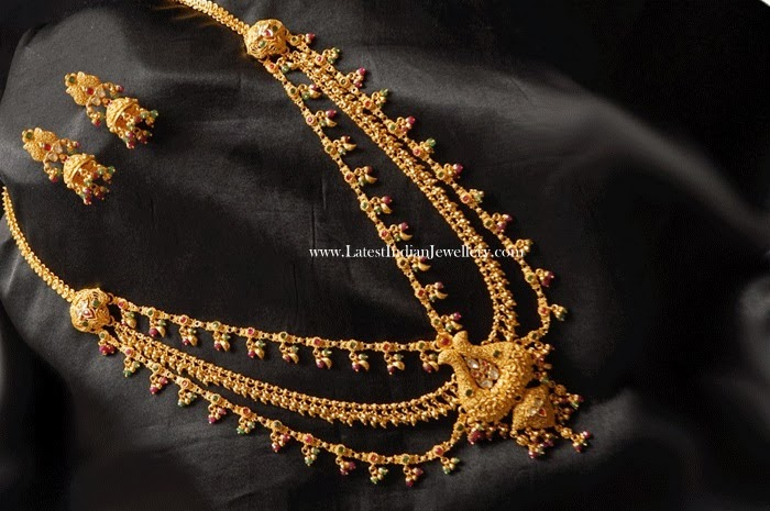 Gold Haram Cum Baby Vaddanam Latest Indian Jewellery Designs