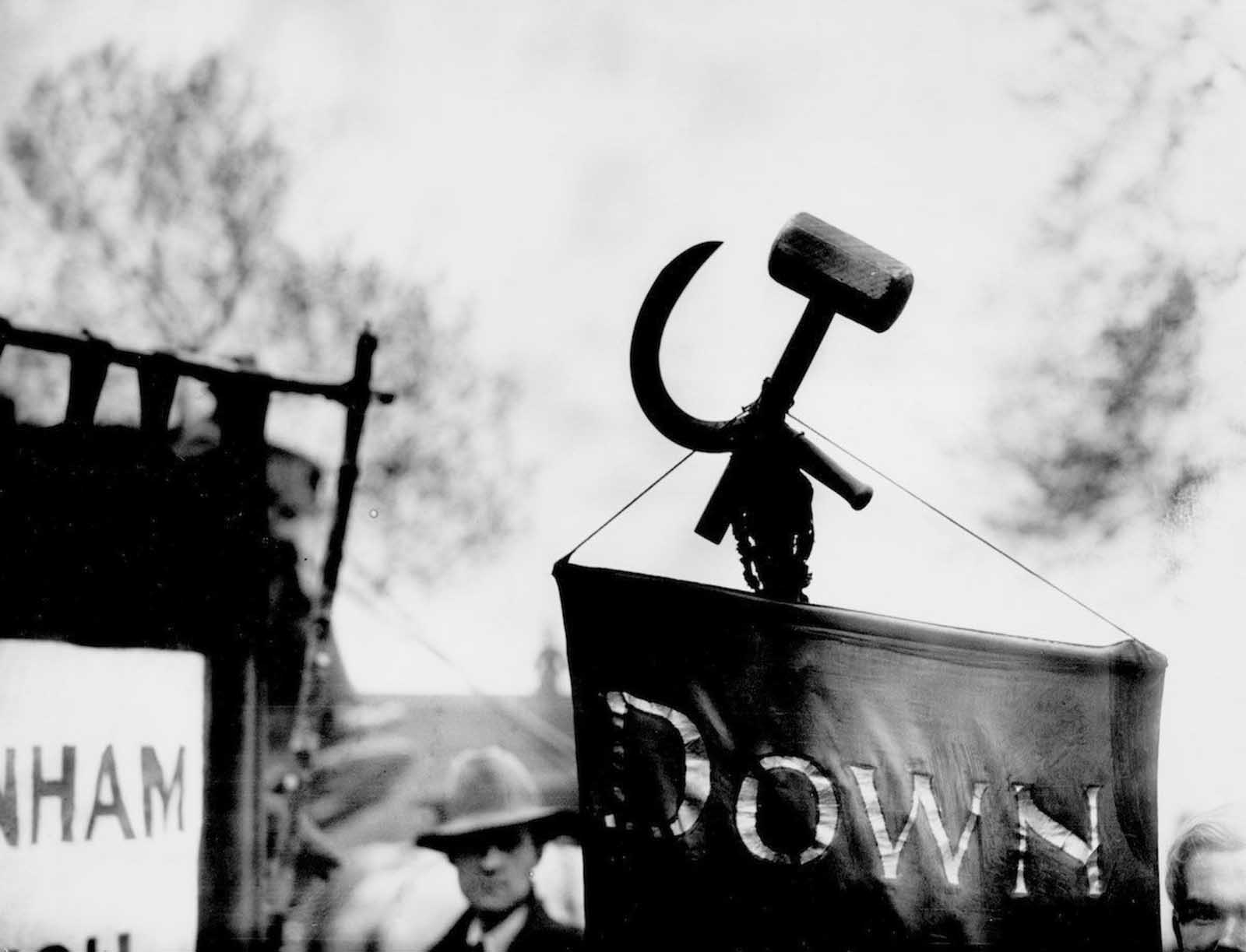 A hammer and sickle attached to a banner at a May Day Labour demonstration. 1928.