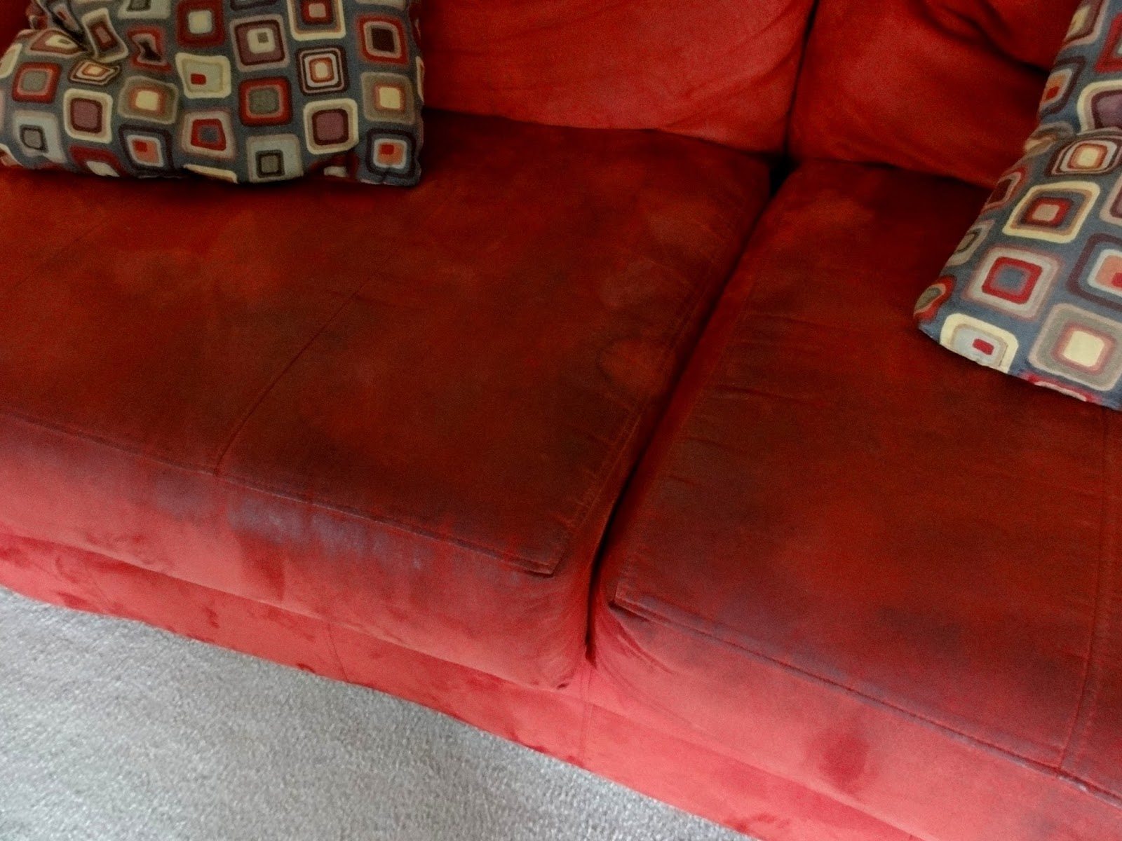 my red couch with stains from hell