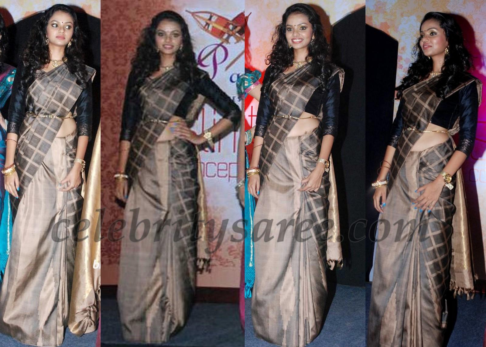 0394b8dbd81e13 Model walks the ramp showcasing black pure traditional silk sari with  checks, Paired with black silk quarter sleeves blouse at Palam Silks Slim  Fit Fashion ...