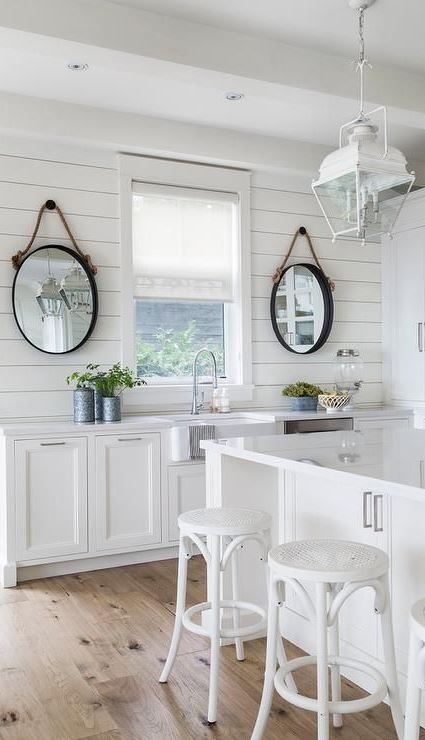 white cottage kitchen with oval rope mirrors