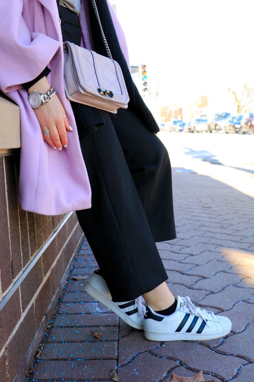 Nyc fashion blogger Kathleen Harper showing how to wear Adidas sneakers