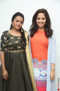 Actress Suma in Black Salwar Suit and Anusuya in orange Dress at winner movie press meet part 1 February 2017 (59).JPG