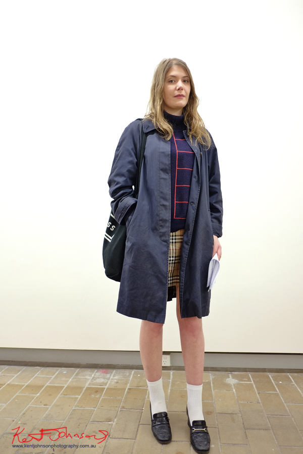 Spring ensemble, light jacket Burberry check skirt, blue designer asymmetric knit jumper. Street Fashion Sydney by Kent Johnson.