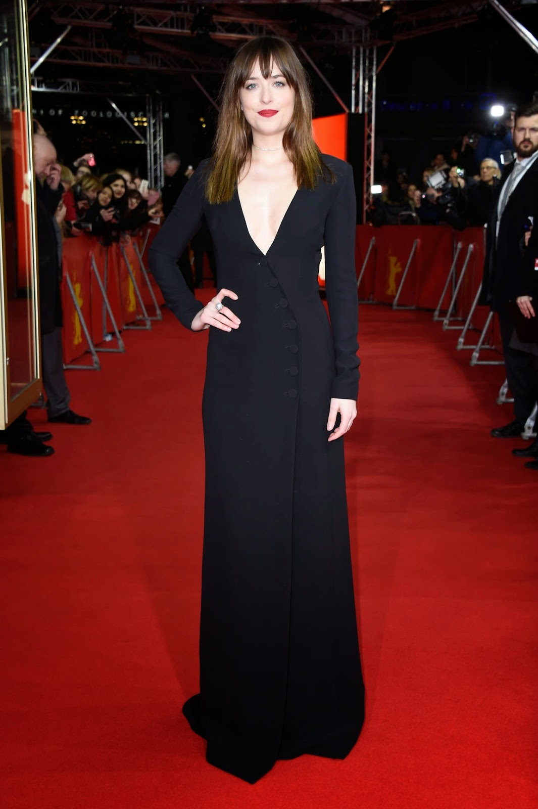 Dakota Johnson wears a plunging Dior dress to the 'Fifty Shades of Grey' Berlin Film Festival premiere