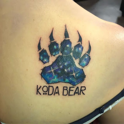 girly shoulder bear claw tattoo or paw tattoo