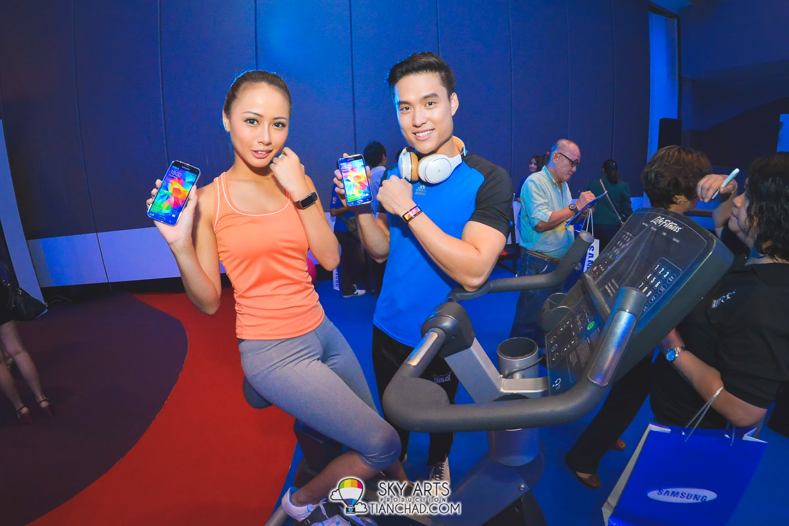 Good looking models showcasing Samsung GALAXY S5 and Samsung Gear Fit