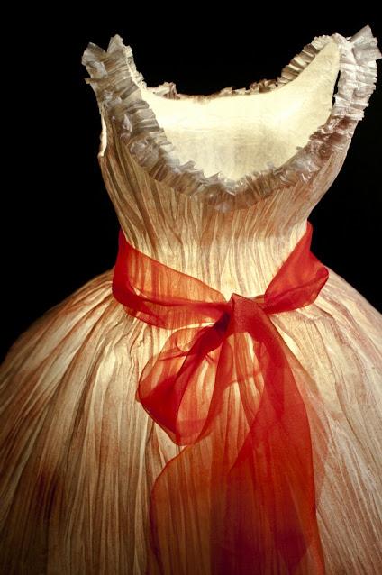 detail of white paper dress