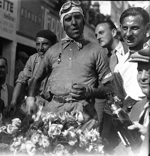 A garlanded Nuvolari after winning the  French Grand Prix in 1932
