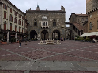 The beautiful Piazza Vecchia lies at the heart of Bergamo's medieval city, the Città Alta