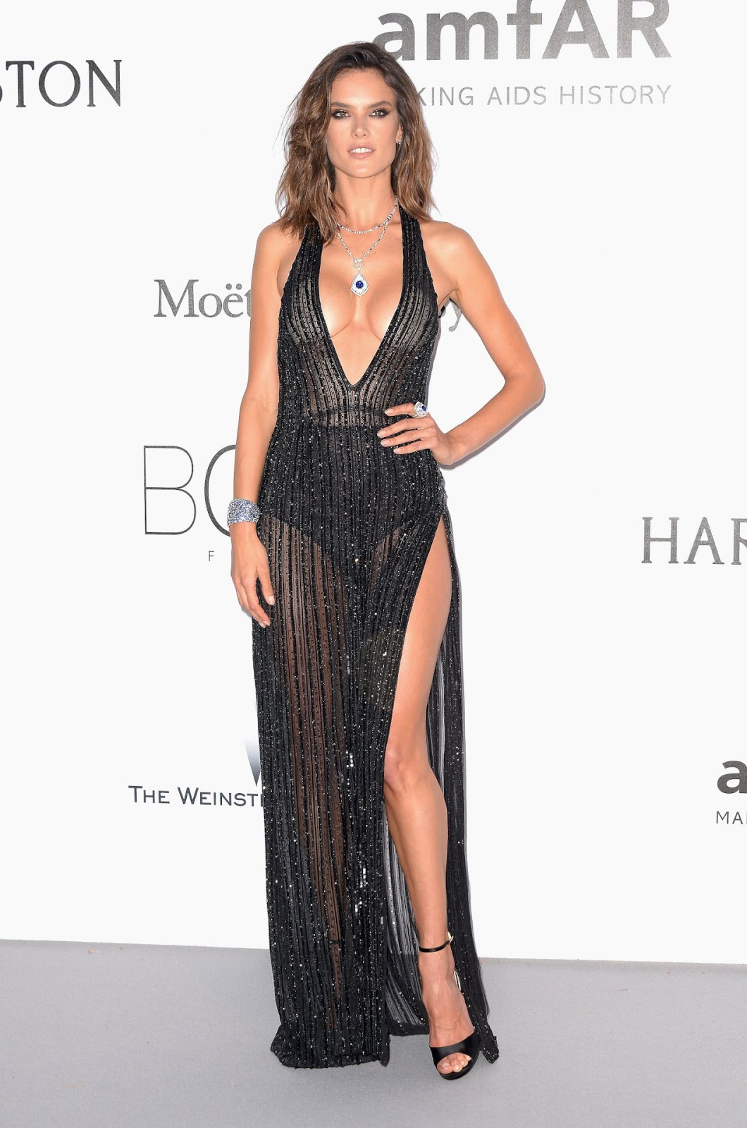 Alessandra Ambrosio goes braless at the amfAR Gala in Cannes