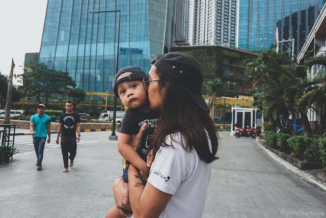 Dad kissing his son