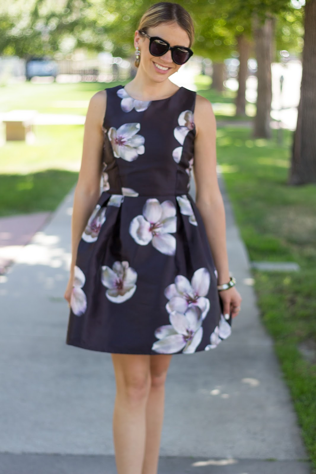 The Black Fit And Flare Frame With Lavender Lilac Colored Fl Accents Make This Dress Easy To Transition From Day Night Beyond