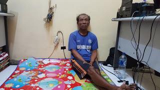 Tersangka Supardjo saat digelandang di kanntor polisi