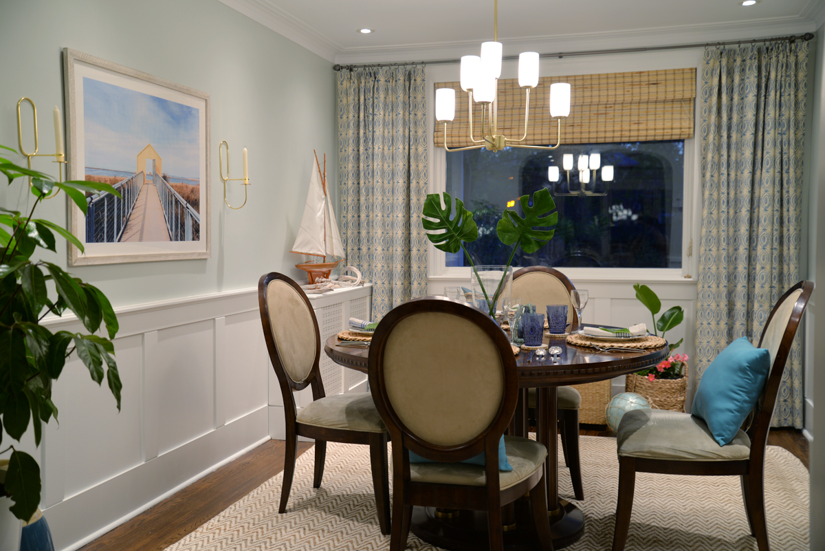 Rambling Renovators | tropical dining room, Hinkley Harlow chandelier, naga blue curtains