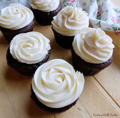 chocolate banana cupcakes with vanilla sweetened condensed milk buttercream piped on top