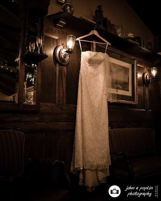 a bride's dress hangs from a ledge before the wedding ceremony in Colorado