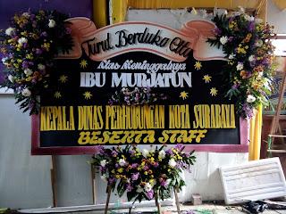 papan bunga deepest condolences