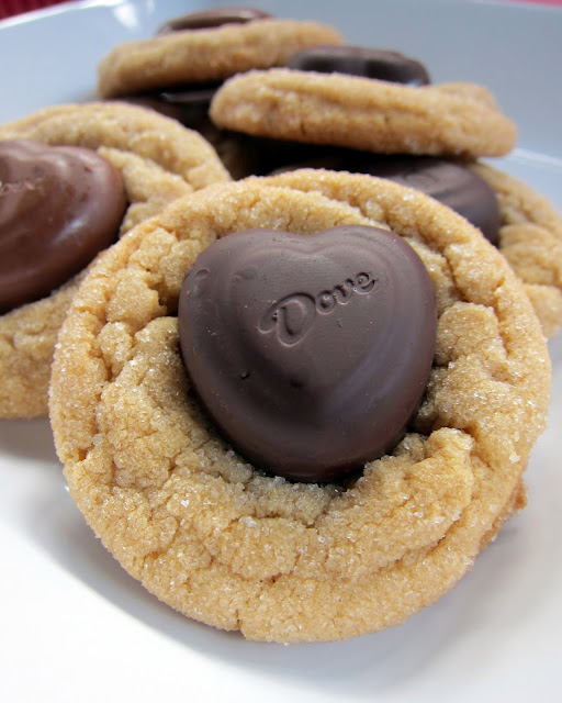 Biscoff Heart Cookies - Biscoff cookies topped with Dove chocolates. Perfect for Valentine's Day!