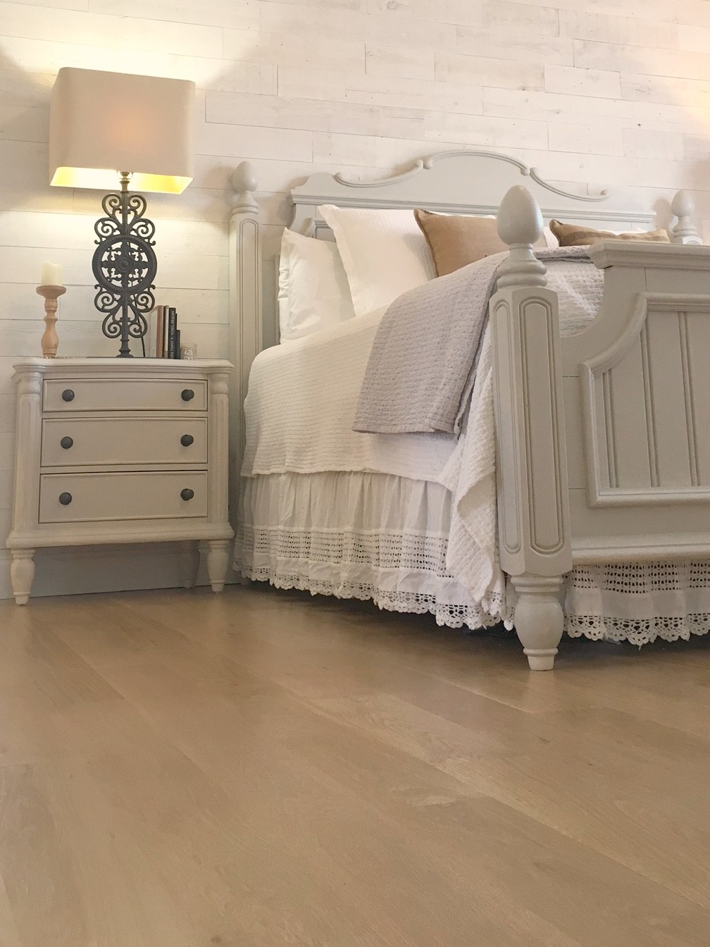 Detail of white oak hardwood floor in farmhouse style master bedroom in Hello Lovely Studio fixer upper