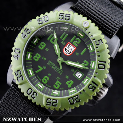 Carbon reinforced polycarbonate case with a green nylon strap. Black  polycarbonate bezel. Black dial with luminous green hands and green Arabic  numeral hour ... 472403b4c8c2